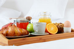 Breakfast in bed in hotel room. Stock Images