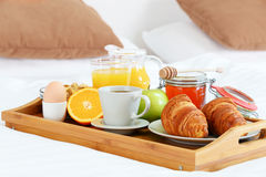 Breakfast in bed in hotel room. Stock Photos