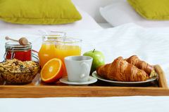 Breakfast in bed in hotel room. Royalty Free Stock Images