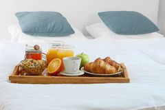 Breakfast in bed in hotel room. Royalty Free Stock Photo