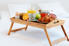 Breakfast in bed in hotel room. Stock Image