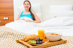 Breakfast in bed of a hotel room Royalty Free Stock Photo
