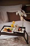 Breakfast in bed at a hotel room Royalty Free Stock Images
