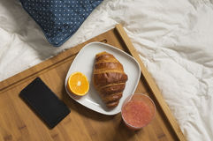 Breakfast at bed with  mobile phone Stock Image
