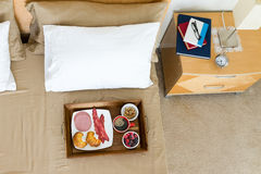 Breakfast in bed with reading books Royalty Free Stock Photo
