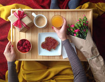Breakfast in bed. Breakfast served in bed on wooden tray Royalty Free Stock Photography