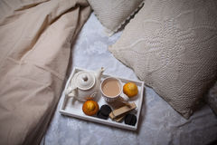Breakfast in bed. Tea and biscuits Royalty Free Stock Photo