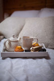 Breakfast in bed. Tea and biscuits royalty free stock photography