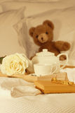 Breakfast in bed with tea and gift Royalty Free Stock Photography