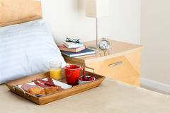Breakfast in Bed Tray on Bed Next to Bedside Table Royalty Free Stock Photo