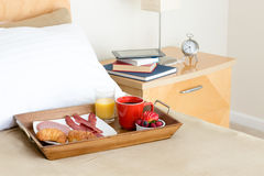 Breakfast in Bed Tray on Bed Beside Night Stand Royalty Free Stock Images