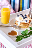 Breakfast in bed on tray with juice Stock Photography