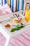 Breakfast in bed on tray with juice Stock Photo