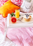 Breakfast in bed on tray with juice Stock Photos