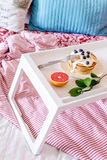 Breakfast in bed on tray with juice Royalty Free Stock Photo