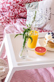 Breakfast in bed on tray with juice Royalty Free Stock Photos