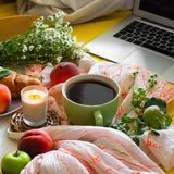 Breakfast in bed, a tray of tea, croissants, fruit, flowers and laptop Morning. Blogger theme. concept of working at home.  stock images
