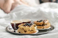 Breakfast in bed. Waffles and coffee on tray Royalty Free Stock Photo