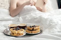Breakfast in bed. Waffles and coffee on tray Stock Photography