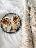 Breakfast in bed. Waffles and coffee on tray Royalty Free Stock Photos