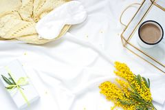 Breakfast in bed white flat lay frame composition with mimosa flowers, a cup of coffee and a gift. Concept woman`s or mother`s day top view. Copy space royalty free stock images