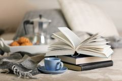 Breakfast in bed. On a white tray there is a coffee maker, coffee blue cup and croissants. Selective focus stock photography