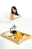 Breakfast in bed woman Royalty Free Stock Photos