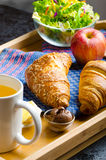Breakfast in bed on wood tray Stock Images