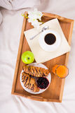 Breakfast in bed on wood tray Stock Photo