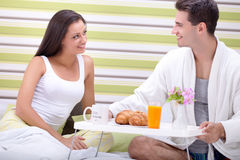 Breakfast in bed. Young couple with breakfast in bed Stock Photo