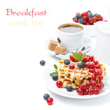Breakfast with Belgian waffles, berries and fresh brewed coffee Stock Photo