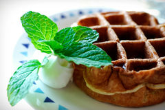 Breakfast with belgian waffles Royalty Free Stock Images