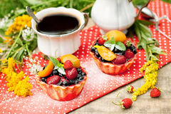 Breakfast with berries cakes and coffee Stock Photos