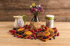 Breakfast with berries, chocolate cookies and milk stock photography
