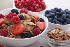 Breakfast - berries, fruit and muesli on white wooden Royalty Free Stock Photos