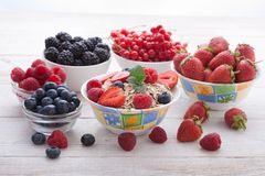 Breakfast - berries, fruit and muesli on white wooden Royalty Free Stock Photography