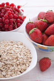 Breakfast - berries, fruit and muesli on white wooden Royalty Free Stock Image