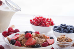 Breakfast - berries, fruit and muesli on white wooden Royalty Free Stock Images