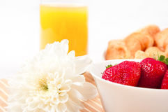 Breakfast with berries,orange juice and croissant Stock Images
