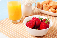 Breakfast with berries,orange juice and croissant Stock Image