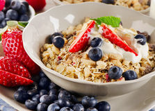 Breakfast with  berries, yogurt and  muesli. Royalty Free Stock Photos