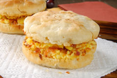 Breakfast biscuit. A ham, egg and cheese breakfast biscuit on a napkin Royalty Free Stock Image