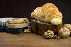 Breakfast biscuit bread croissant. Breakfast biscuit croissant coffee on teak table Stock Photos