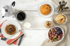 Breakfast with biscuits, chocolate, fruit and coffee milk Royalty Free Stock Photos