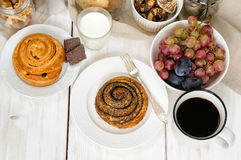 Breakfast with biscuits, chocolate, fruit and coffee milk Stock Photos