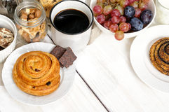 Breakfast with biscuits, chocolate, fruit and coffee milk Royalty Free Stock Photography