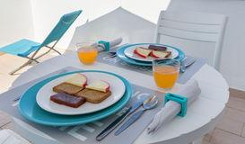 Breakfast of black bread, orange juice and bread. Royalty Free Stock Images