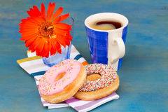Breakfast with black coffee and donuts Stock Image