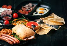 Breakfast on a black wooden table in rustic style.  Stock Images