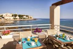 Breakfast on a blue sea Stock Photo